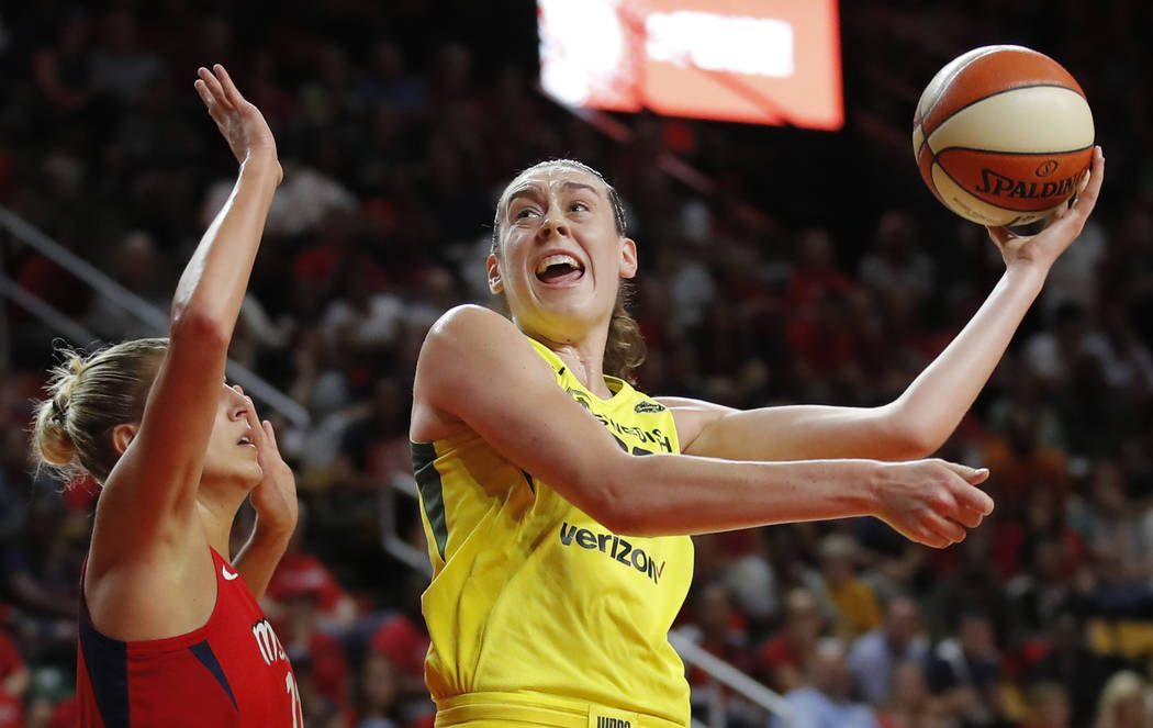 Seattle Storm forward Breanna Stewart (30) shoots as Washington Mystics forward Elena Delle Don ...