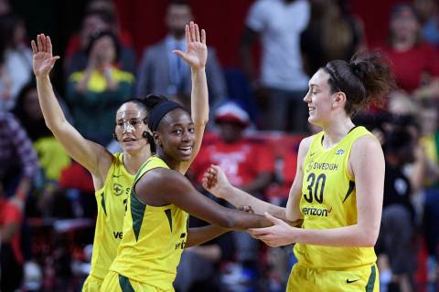In this Wednesday, Sept. 12, 2018, file photo, from left, Seattle Storm's Sue Bird, Jewell Loyd ...