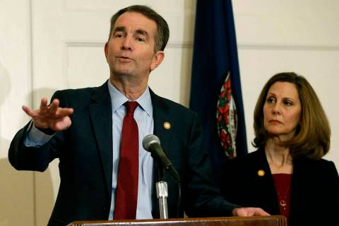 FILE - In this Feb. 2, 2019 file photo, Virginia Gov. Ralph Northam, left, gestures as his wife ...