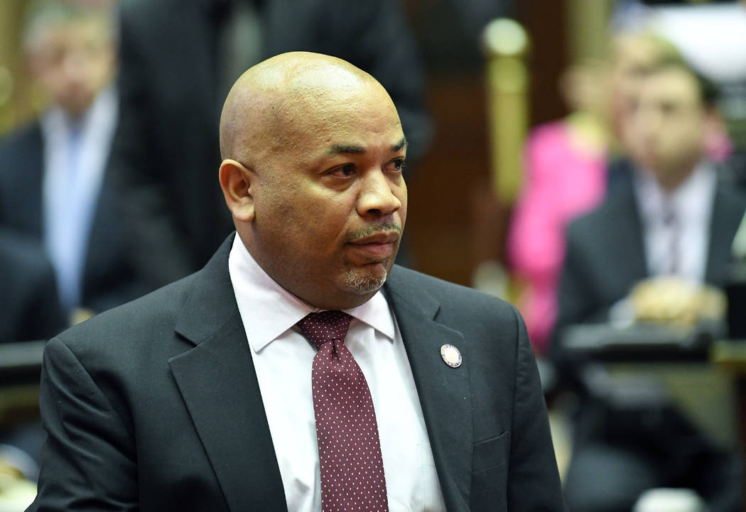 Assembly Speaker Carl Heastie, D-Bronx, left, walks on the Assembly floor as members of the New ...