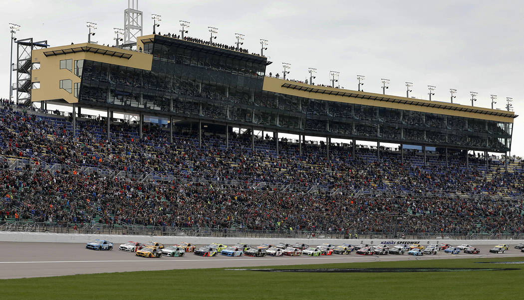 Drivers start the NASCAR Cup Series auto race at Kansas Speedway in Kansas City, Kan., Saturday ...