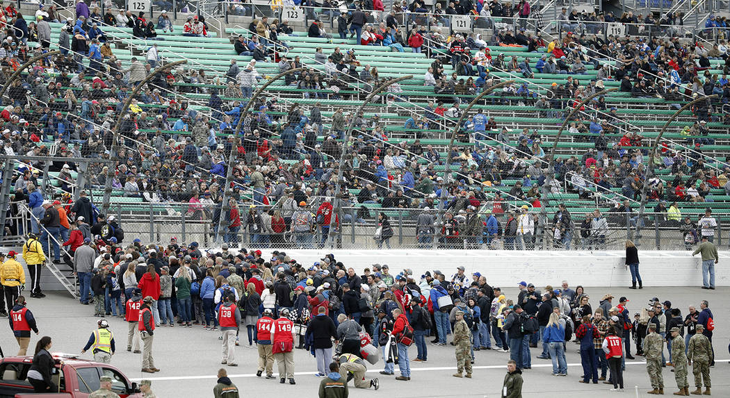 Fans return to the stands following an infield concert before a NASCAR Cup Series auto race at ...