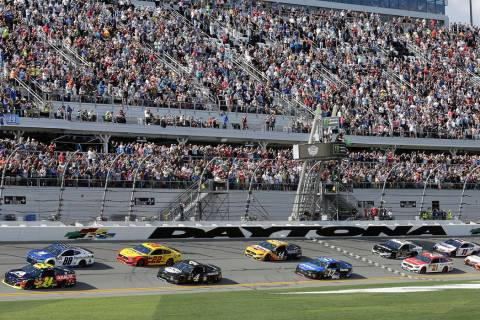 In a Feb. 17, 2019, file photo, William Byron (24) and Alex Bowman (88) lead the field to start ...