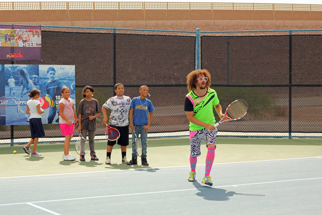 Pop star and tennis buff Redfoo works with youth players at the 2012 Party Rock Open at Darling ...