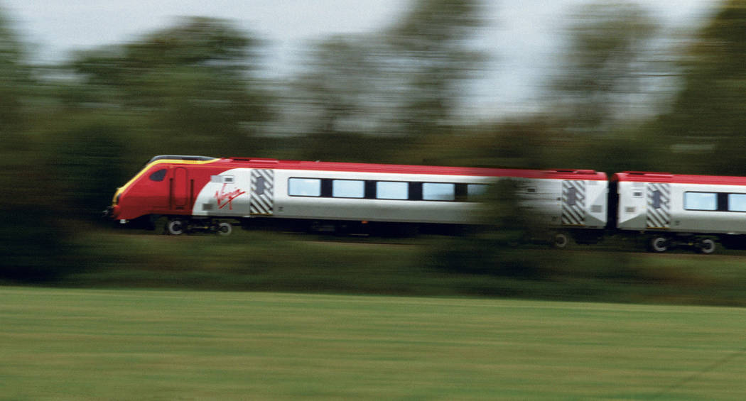 A high-speed Virgin Trains commuter train that travels between England and Scottland is shown i ...