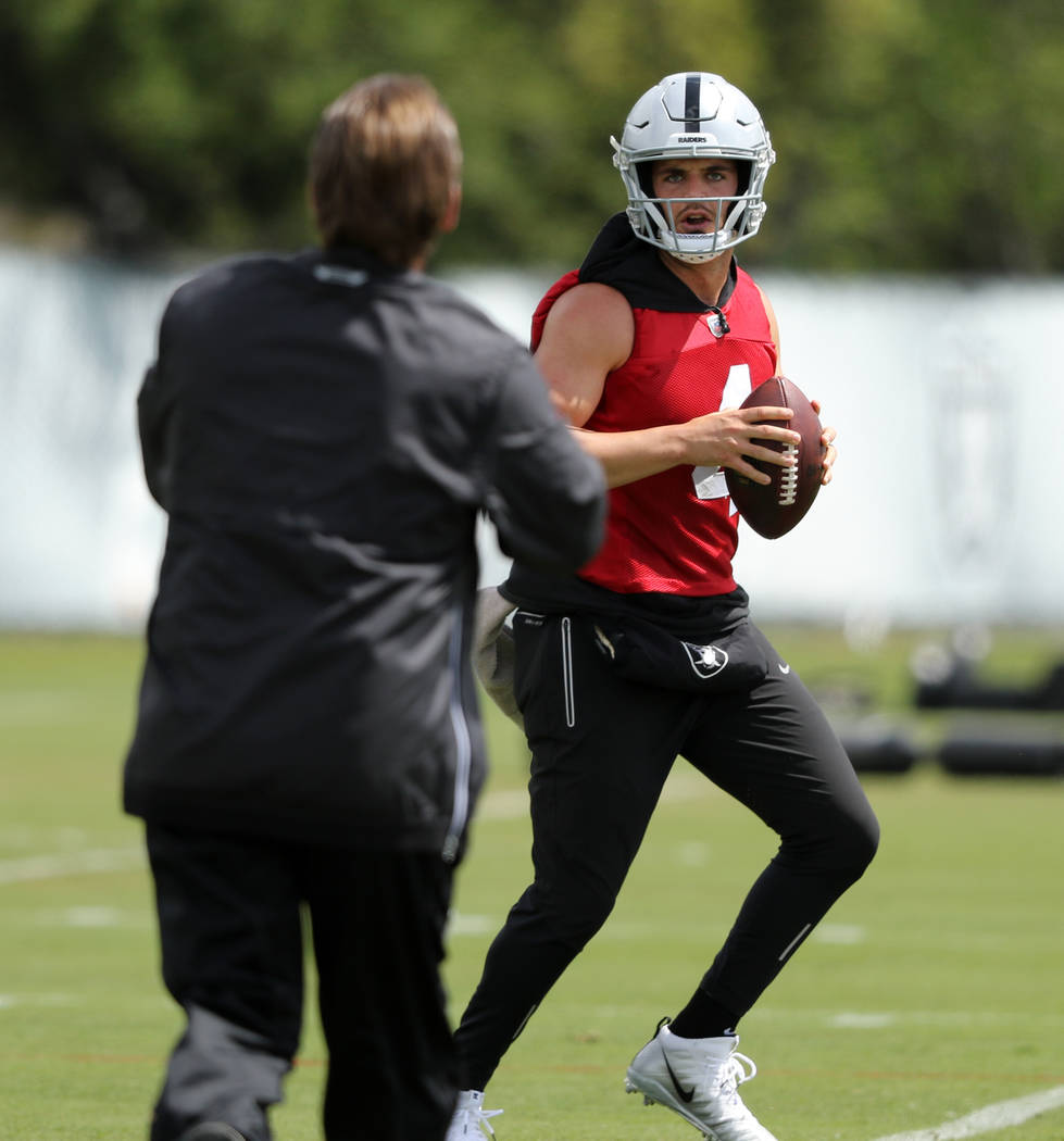 Oakland Raiders quarterback Derek Carr prepares to throw the football during an offseason train ...