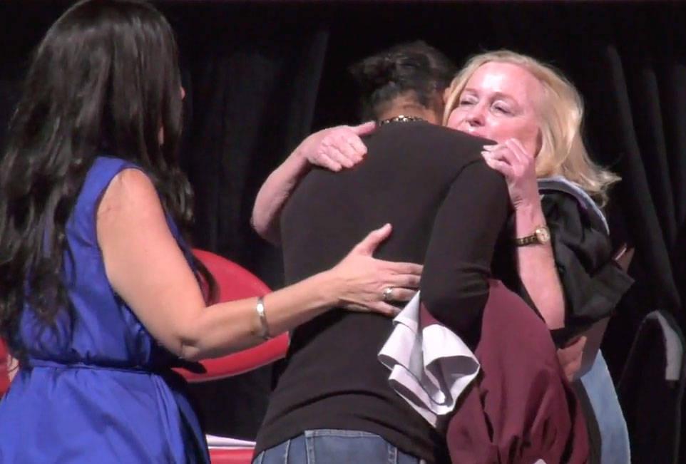 Christian Sigler hugs Cimarron-Memorial High School Principal Lori Lawson Sarabyn after receivi ...
