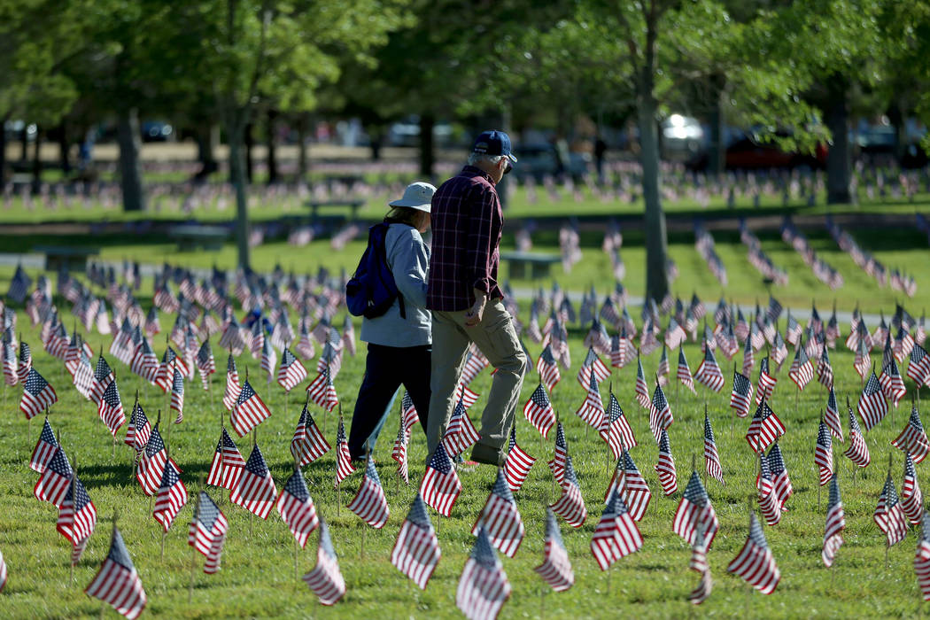 "Flags fly above grave sites during the annual ""Flag-In"" event at the Southern Nev ..."