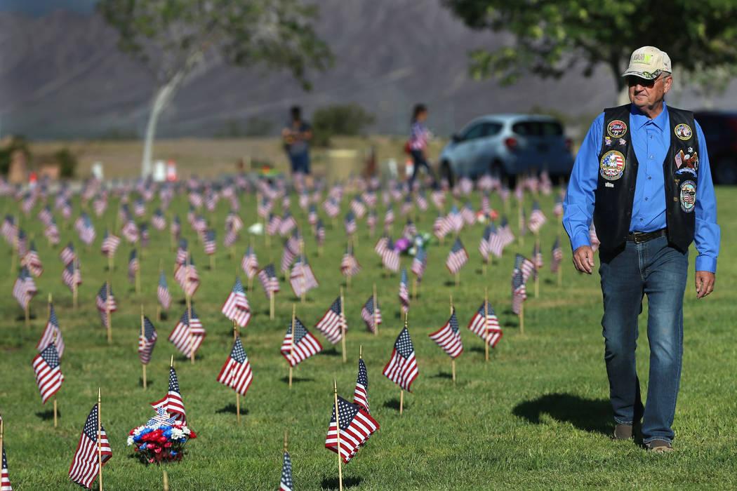 U.S. Navy veteran Michael Schuenke walks the Southern Nevada Veterans Memorial Cemetery in Boul ...