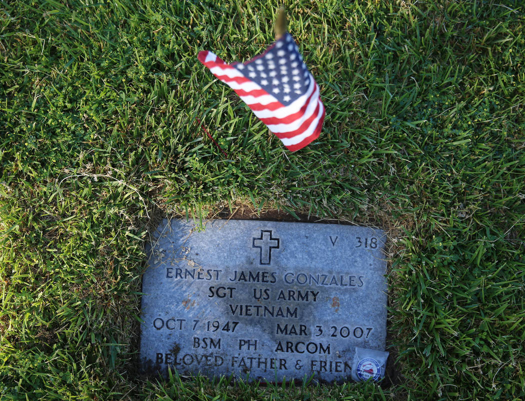 The gravesite of Ernest James Gonzales, U.S. Army veteran who served in Vietnam, during the ann ...