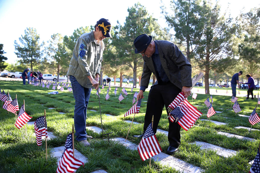 Nevada Department of Veterans Services Director Kat Miller, left, and volunteer Richard Armstro ...