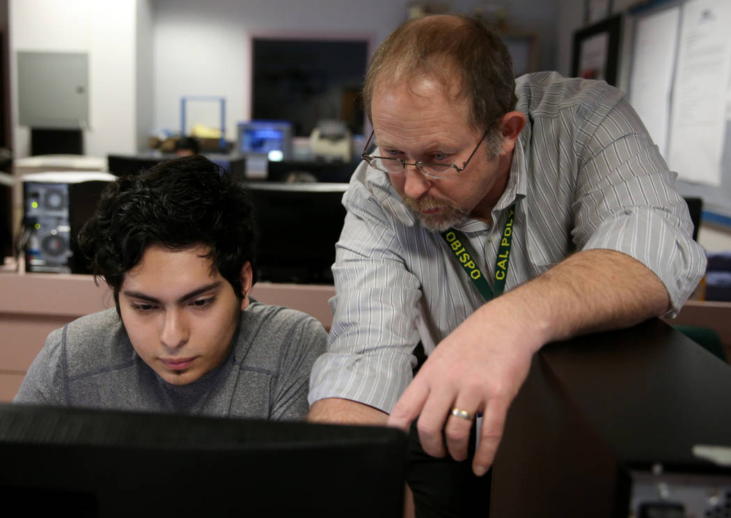 Advanced Technologies Academy teacher Richard Knoeppel, the Nevada Teacher of the Year, works w ...