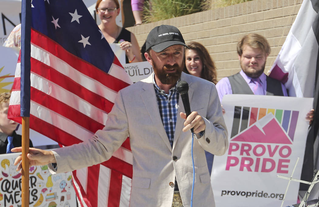 FILE - In this June 14, 2018 file photo, Utah County Commissioner Nathan Ivie speaks as he hold ...