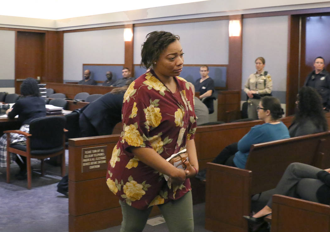 Cadesha Bishop, 25, accused of shoving a 74-year-old man off a bus, leaves the courtroom after ...