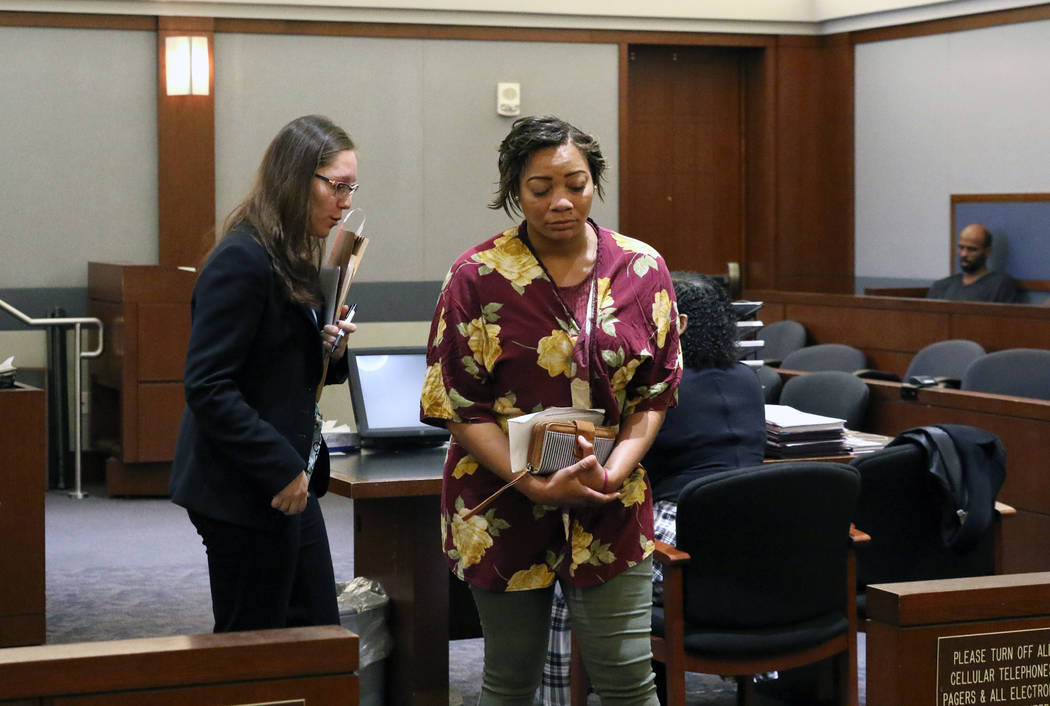 Cadesha Bishop, 25, right, accused of shoving a 74-year-old man off a bus, leaves the courtroom ...