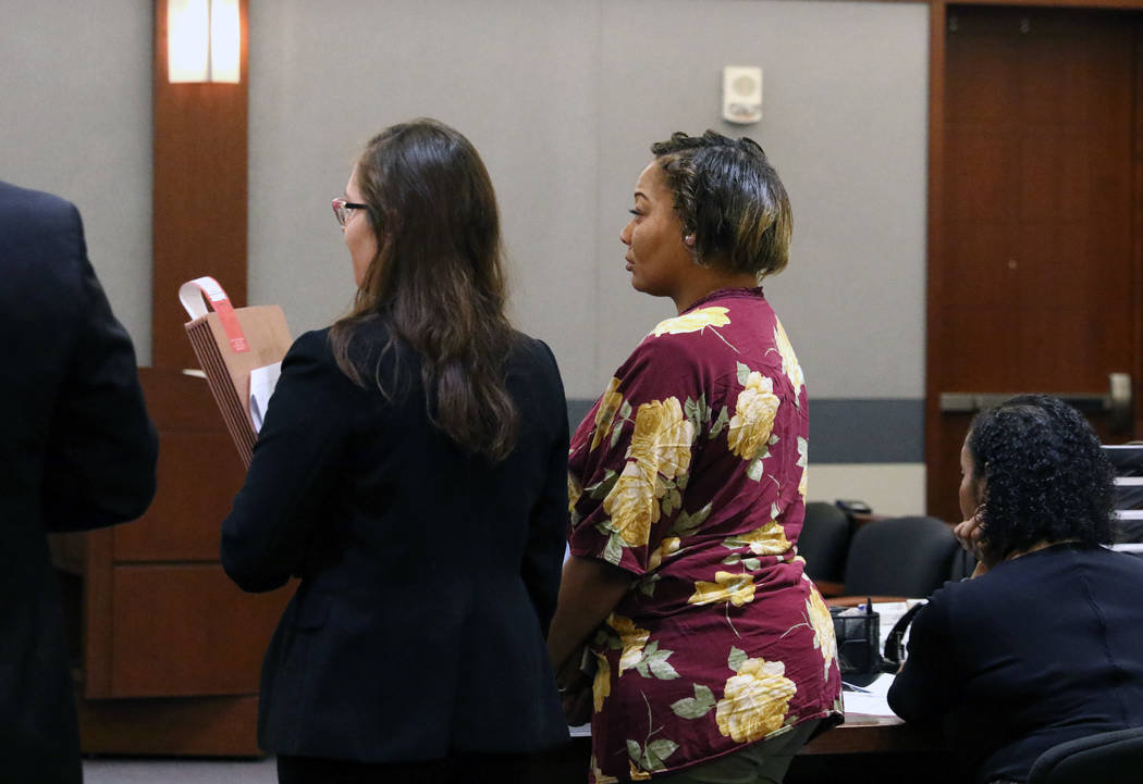 Cadesha Bishop, 25, right, accused of shoving a 74-year-old man off a bus, appears in court wit ...
