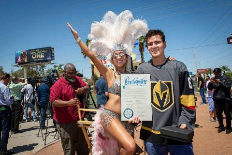 "Heather Neckritz, left, poses for a photograph with ""Jeopardy!"" sensation James Holzhauer after ..."
