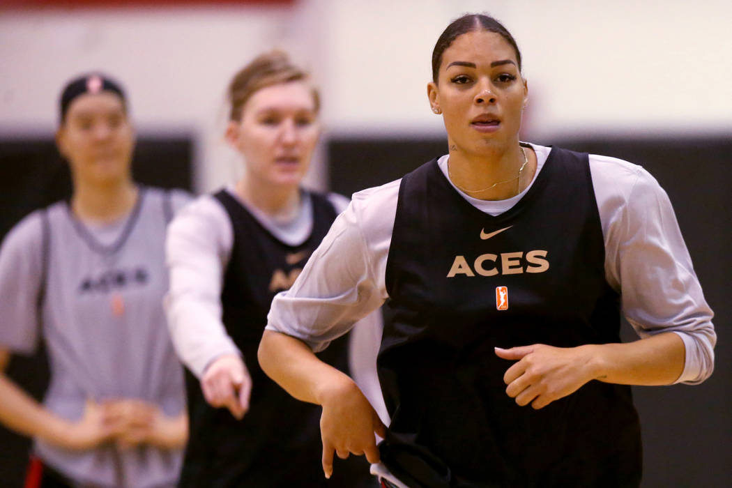 Aces center Liz Cambage, right, with JiSu Park, left, and forward Carolyn Swords during practic ...