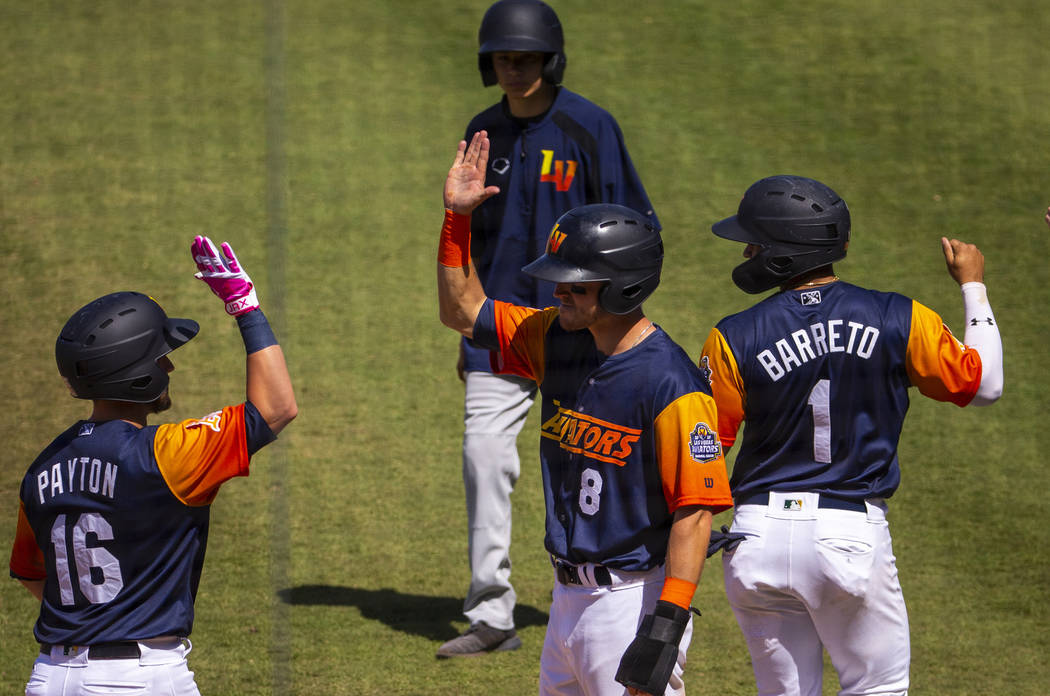 Aviators players celebrate a grand slam late in the game versus the Tacoma Rainiers at the Las ...