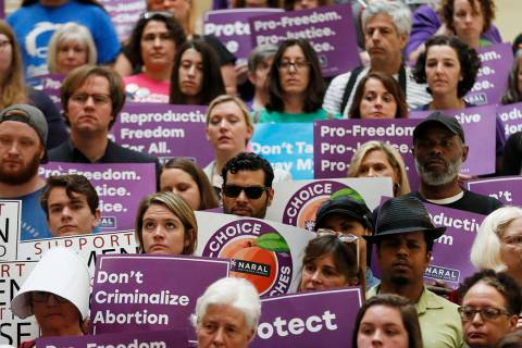 Abortion rights supporters stand during a news conference by Presidential candidate Sen. Kirste ...