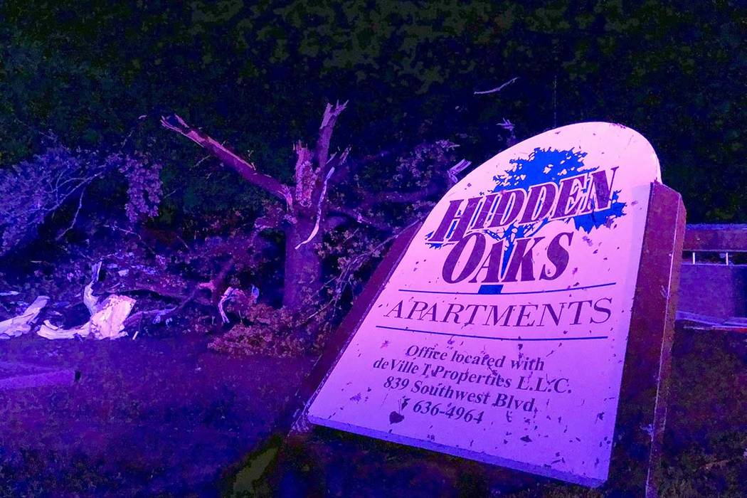 The sign for the Hidden Oaks apartment complex in Jefferson City Missouri stands bent on May 23 ...