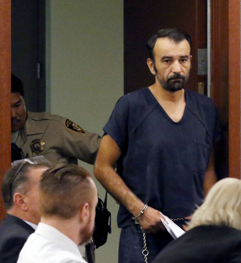 Slobodan Miljus, accused of killing his wife with baseball bat, led into the courtroom at the R ...