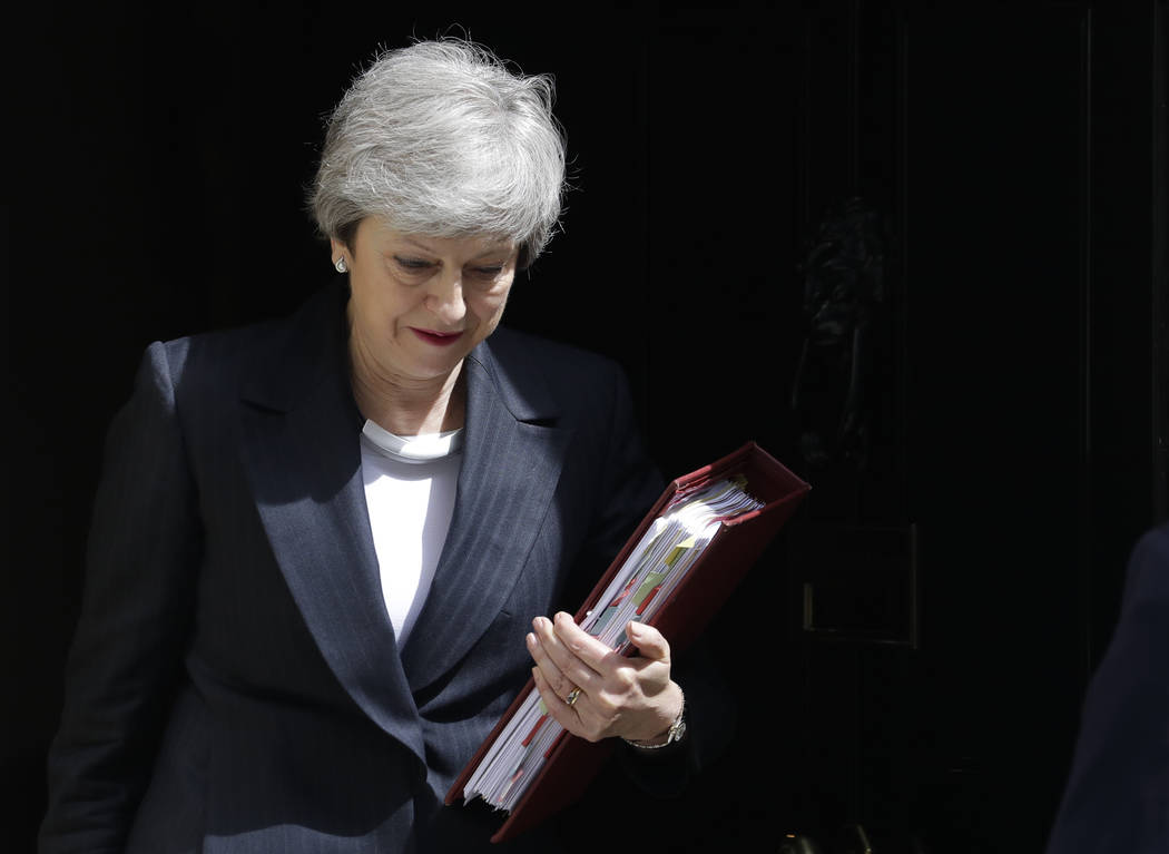 Britain's Prime Minister Theresa May leaves 10 Downing Street to attend the weekly session of P ...
