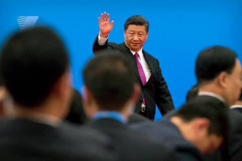 In a Saturday, April 27, 2019, file photo, Chinese President Xi Jinping waves as he leaves afte ...