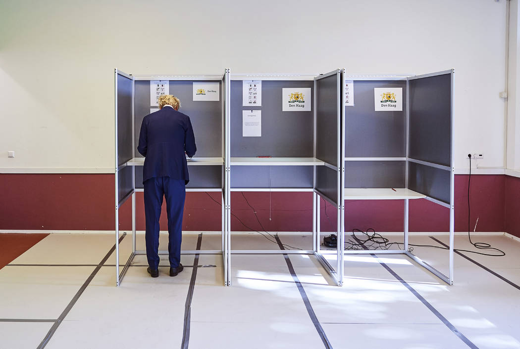 Geert Wilders, leader of the Dutch Party for Freedom, casts his ballot in the European election ...