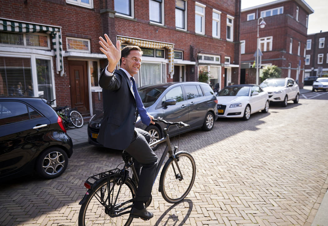 Netherlands Prime Minister Mark Rutte leaves on his bike after voting in the European elections ...