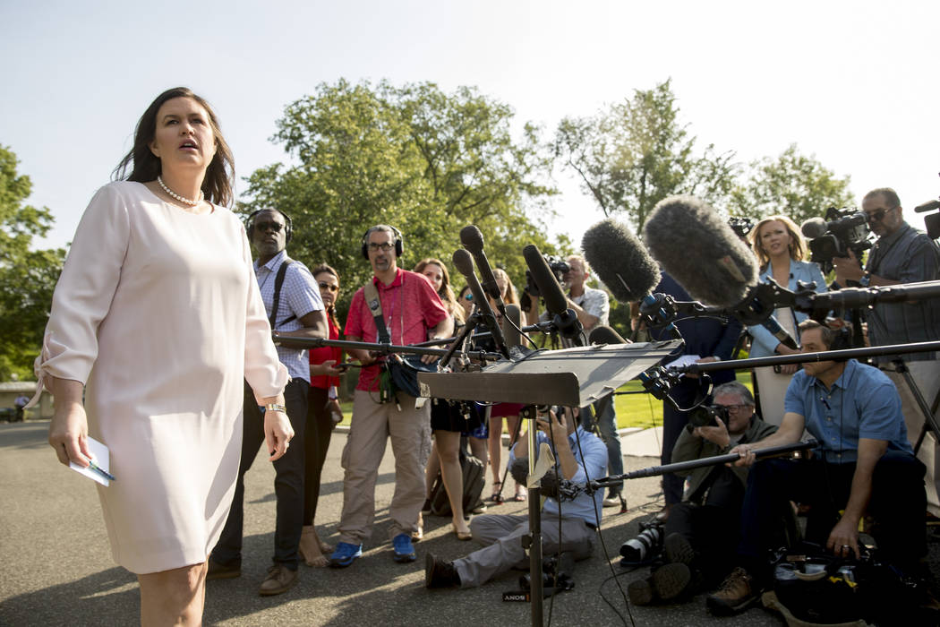 White House press secretary Sarah Huckabee Sanders takes a question from a reporter on the Nort ...