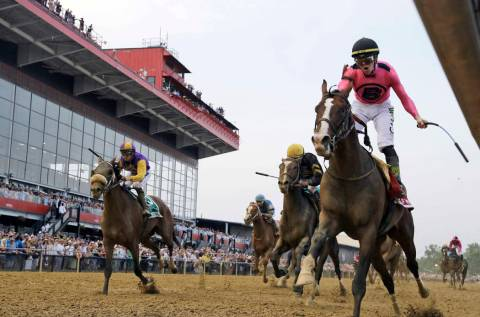Jockey Tyler Gaffalione, right, reacts aboard War of Will, as they crosses the finish line firs ...