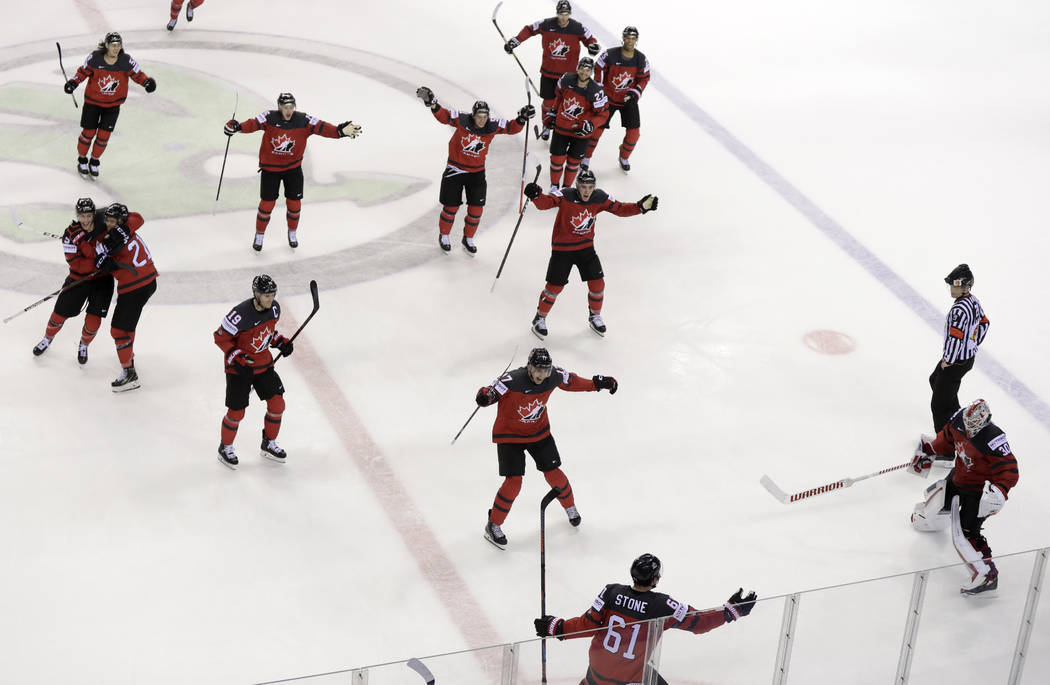 Canada's Mark Stone, foreground, celebrates after scoring his side's third goal during the Ice ...