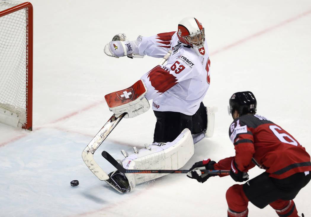 Canada's Mark Stone, right, scores his side's third goal past Switzerland's goalkeeper Leonardo ...