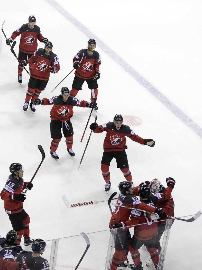 Canada's Mark Stone, 2nd right foreground, celebrates after scoring his side's third goal durin ...