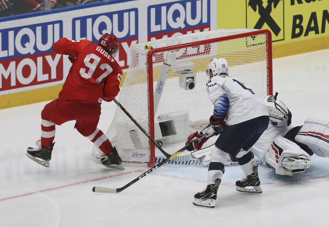 Russia's Nikita Gusev, left, scores his side's first goal during the Ice Hockey World Champions ...