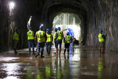 Members of the media and workers during tour of the Southern Nevada Water Authority's low-lake- ...