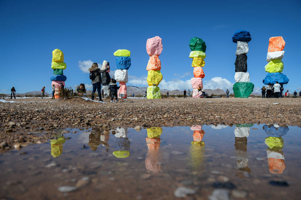 Tourists visit the Seven Magic Mountains in Clark County, Monday, Feb. 18, 2019. (Caroline Breh ...