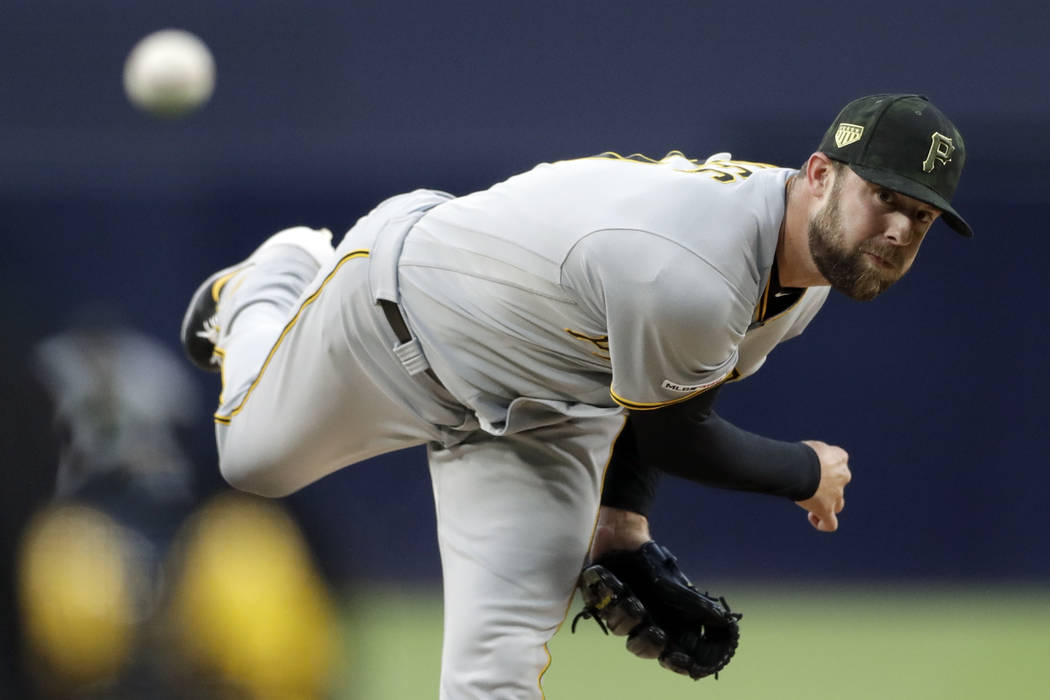 Pittsburgh Pirates starting pitcher Jordan Lyles works against a San Diego Padres batter during ...