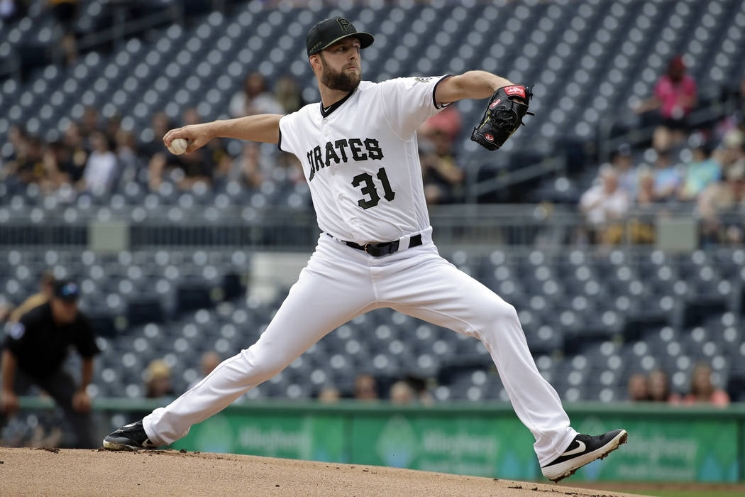 Pittsburgh Pirates relief pitcher Jordan Lyles delivers in the first inning of the team's baseb ...