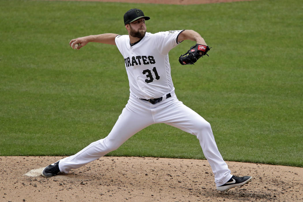 Pittsburgh Pirates starting pitcher Jordan Lyles delivers in the sixth inning of a baseball gam ...