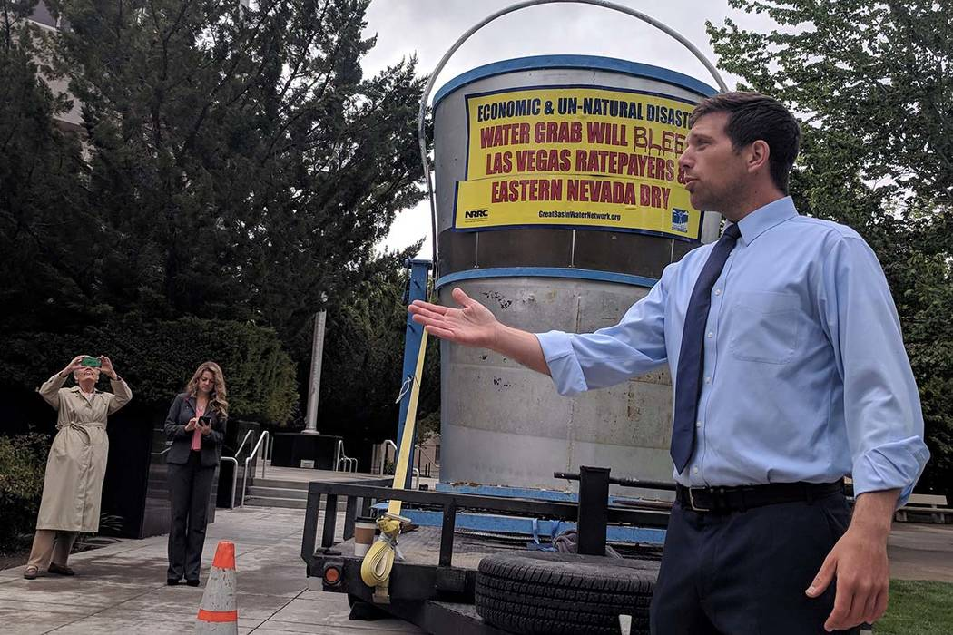 Kyle Roerink, executive director of Great Basin Water Network, speaks during a demonstration ou ...