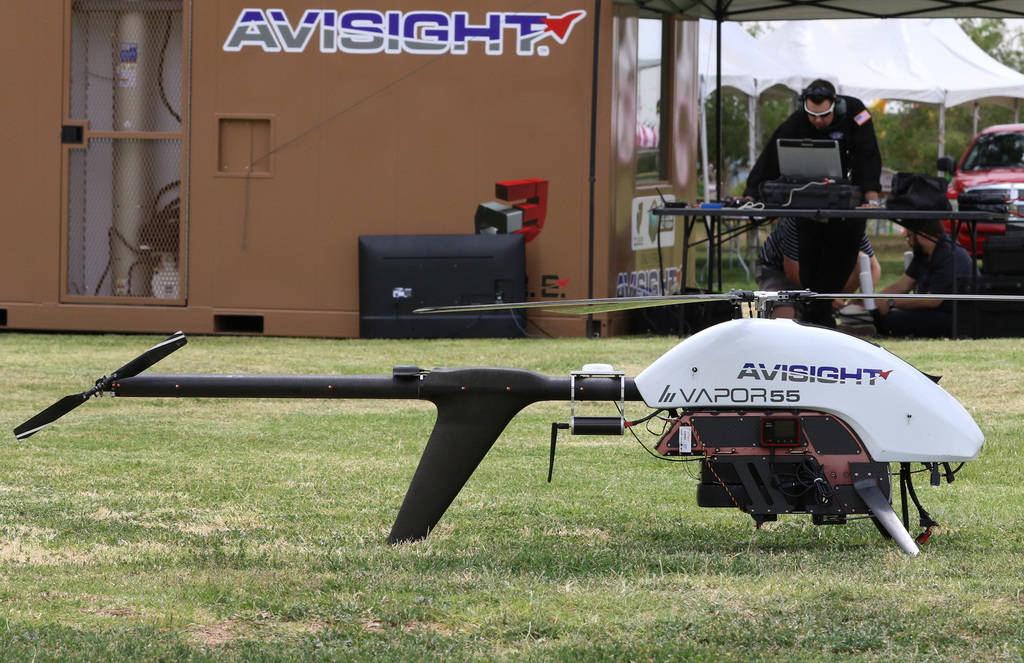 Jason Daub, a pilot in command, prepares to fly the Vapor 55 unmanned helicopter over Craig Ran ...