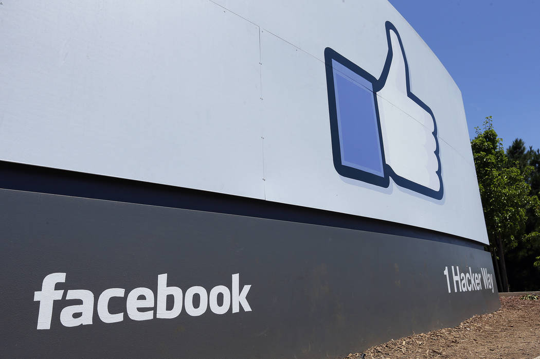 A July 16, 2013, file photo shows a sign at Facebook headquarters in Menlo Park, Calif. Faceboo ...