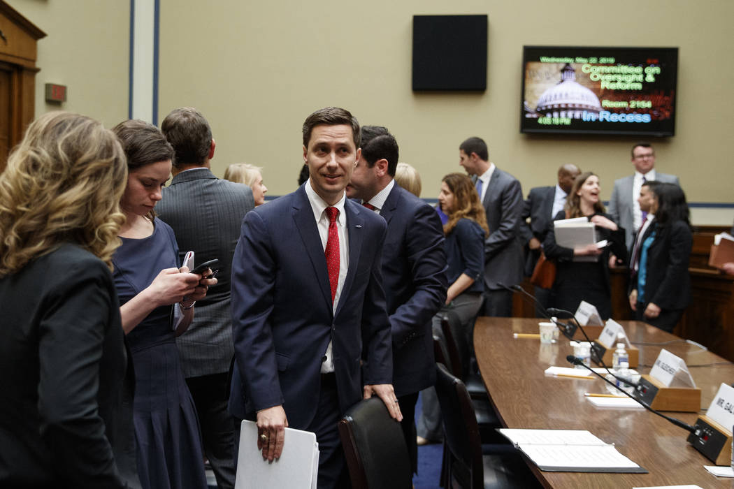 Twitter Public Policy Manager Kevin Kane walks from the hearing room during a break in testimon ...