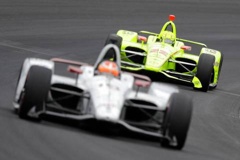 Simon Pagenaud, of France, follows Santino Ferrucci into turn one during practice for the India ...