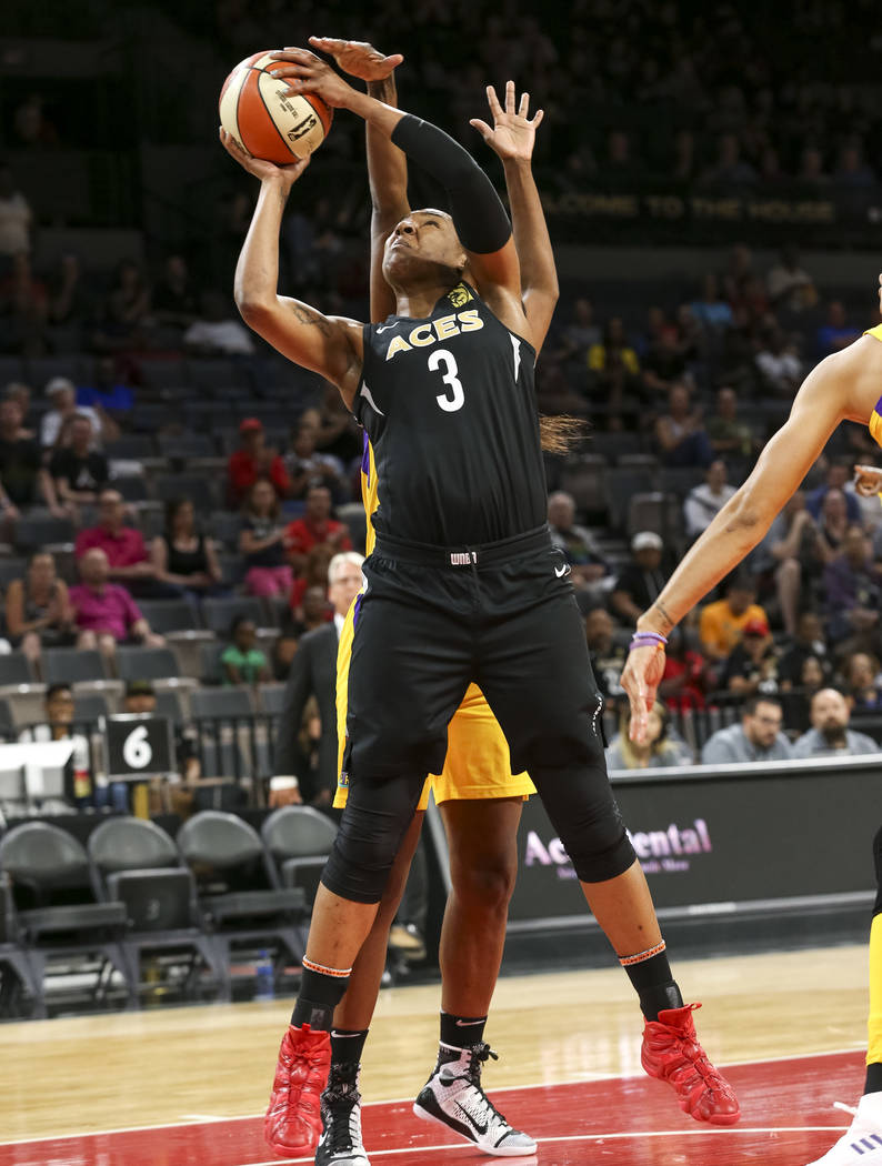 Las Vegas Aces center Kelsey Bone (3) shoots as Los Angeles Sparks center Jantel Lavender (42), ...
