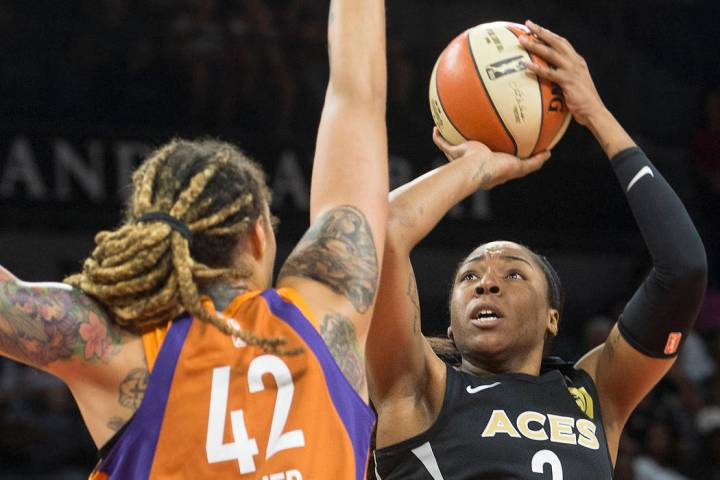 Aces center Kelsey Bone (3) shoots over Phoenix Mercury center Brittney Griner (42) in the firs ...