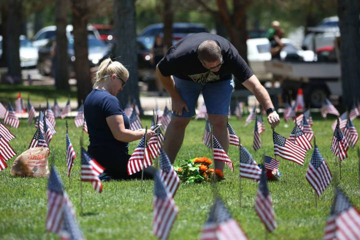 Gus Chaltas visits his parents' grave with his wife Jennifer on Memorial Day at the Southern Ne ...