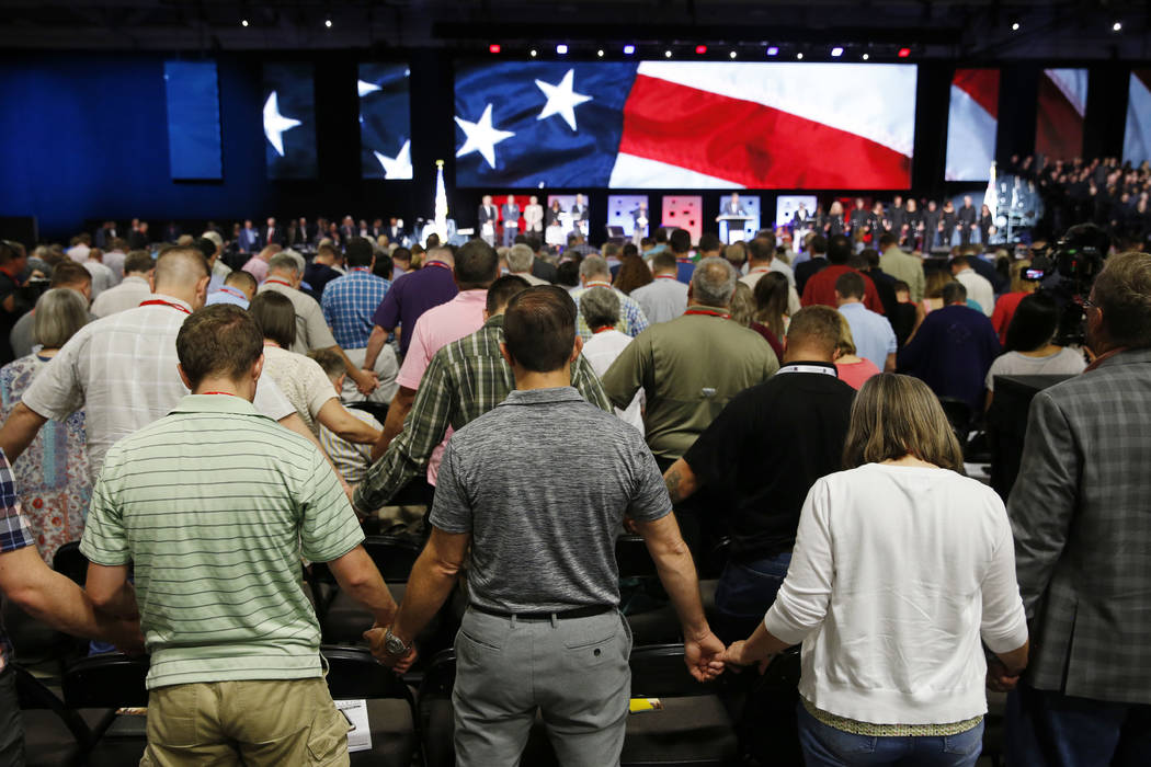 FILE - In this June 12, 2018 file photo, people pray for America at the 2018 annual meeting of ...